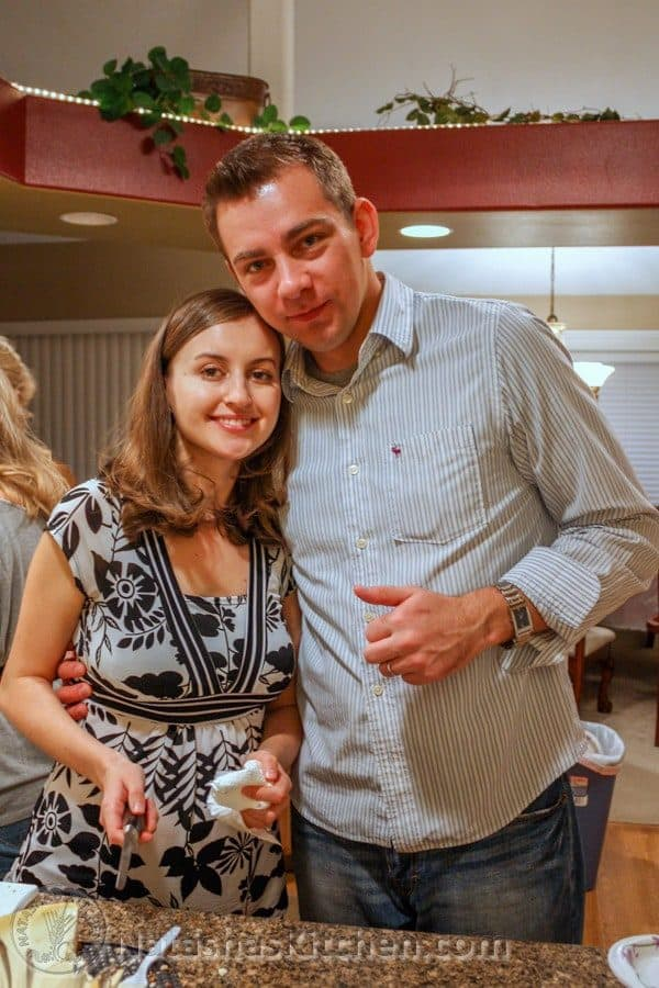 Natasha and her husband smiling in a kitchen