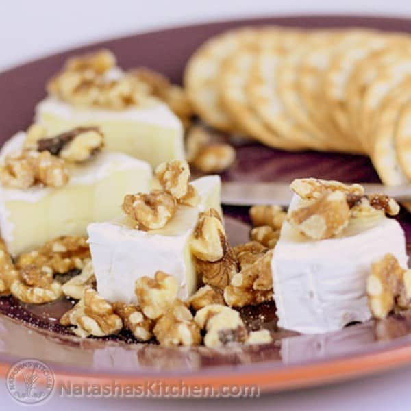 The combination of brie with walnuts, dripping with honey is addictive. It always goes fast when served at parties and so easy to put it together.