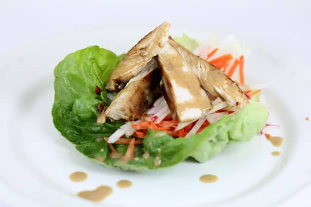 A white plate with Terah's delicious lettuce wraps
