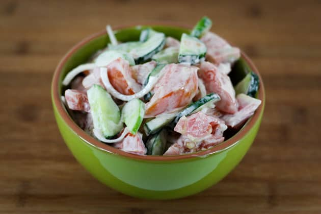 Creamy Cucumber and Tomato Salad in a green bowl