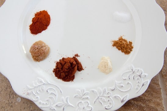 A plate with different spices for a spice-rubbed sirloin