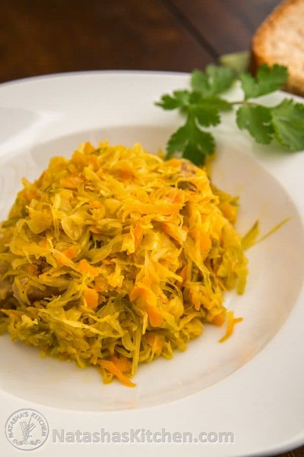 A white plate of Russian braised cabbage