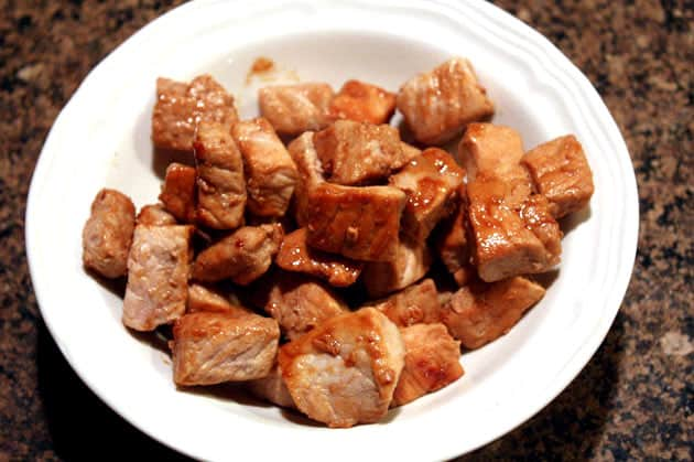 Cooked pork in a white bowl