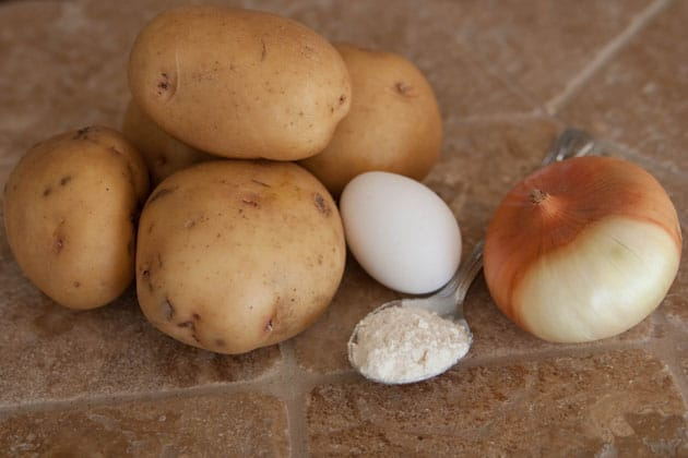 Ingredients for deruny, Ukrainian potato pancakes on the table