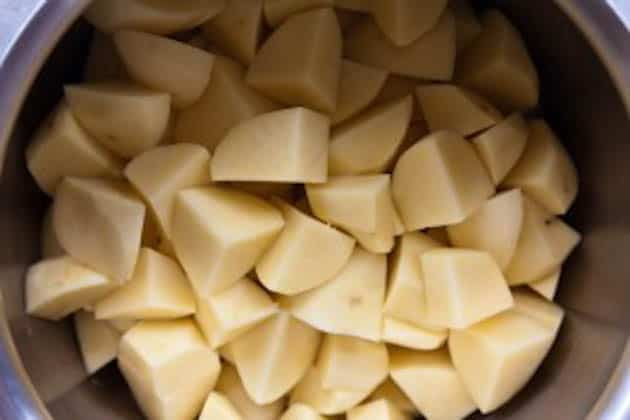 Peeled and cut potatoes in a pot
