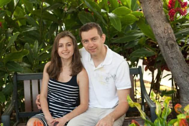 Natasha and her husband sitting on a bench