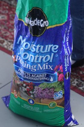 A bag of Moisture Control potting mix