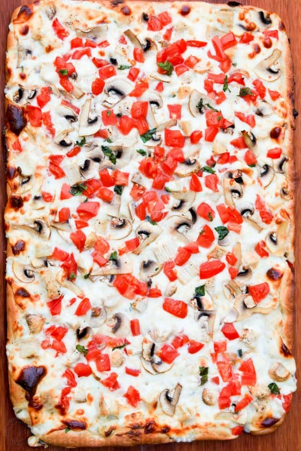 A large chicken pizza with creamy garlic sauce