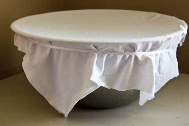 A large bowl covered with a cheesecloth