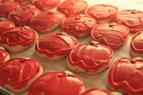 A tray of apple-shaped cookies
