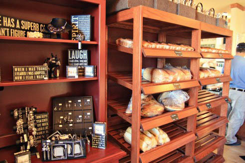 A shelf with different kinds of bread