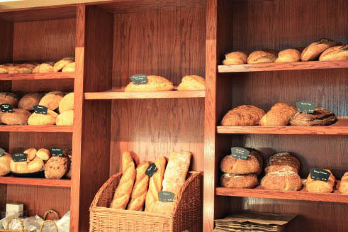A shelf of different breads