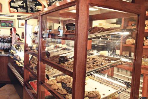 A shelf in a bakery