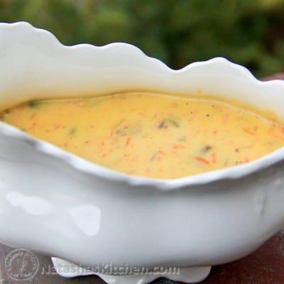 A white, gravy bowl with mushroom gravy