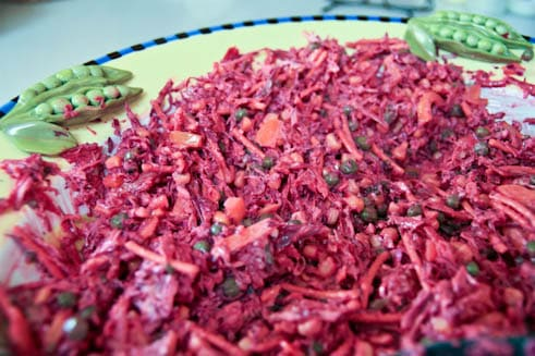 A close up of the red cabbage wreath salad mixed with the dressing