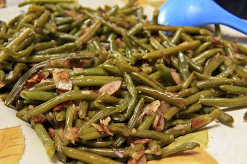 A plate with almond green beans