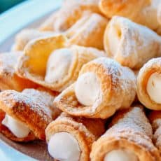 These puff pastry cream horns are easy and impressive for any special occasion! This is my Mother's cream horns recipe (aka trubochki).