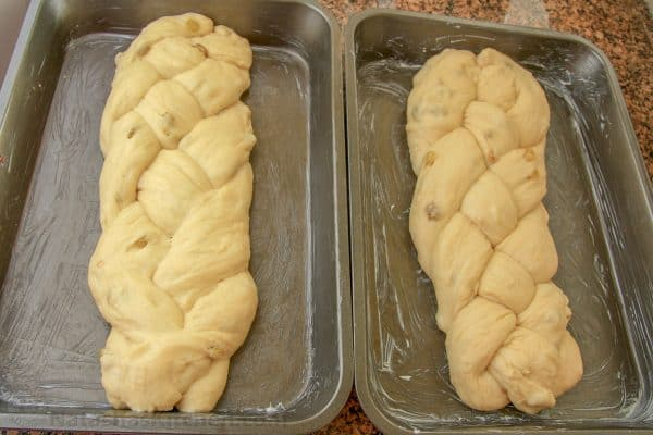 Two pans with two loaves of Portuguese Easter bread