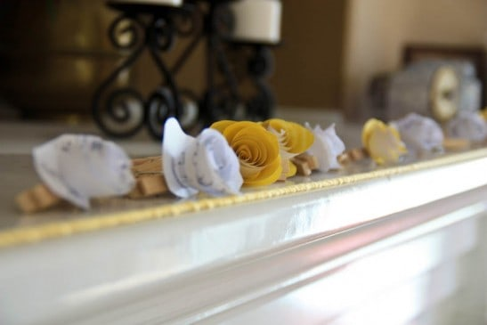 Yellow decorations on fire place sill