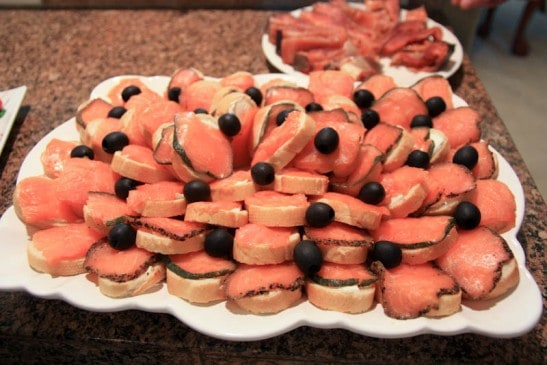 Salmon canapés stacked on a plate