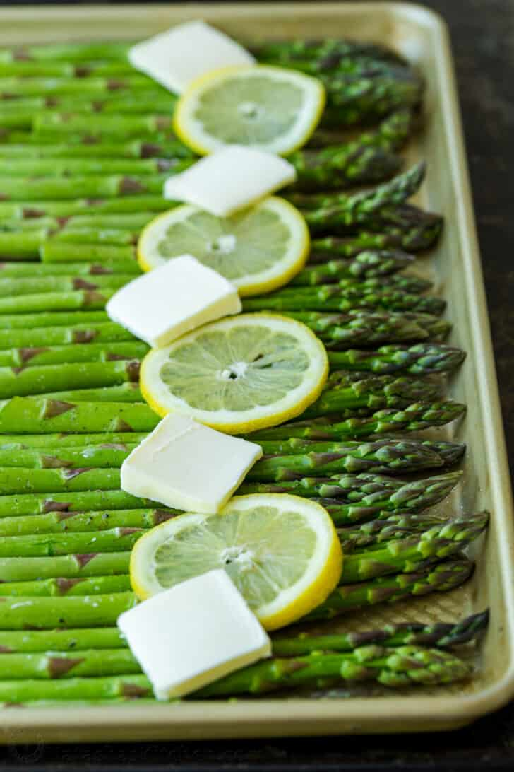Asparagus on baking sheet, ready to be baked in the oven