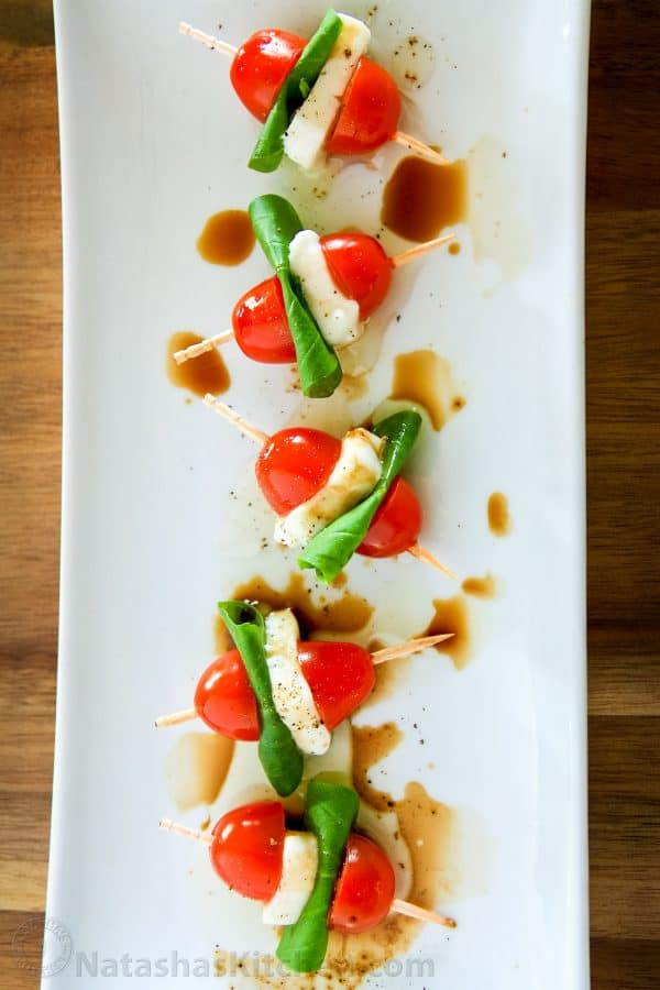 A plate with Caprese salad skewers