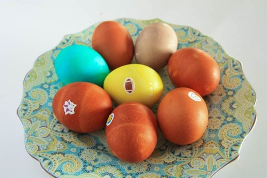 A plate with colored Easter eggs and stickers on them