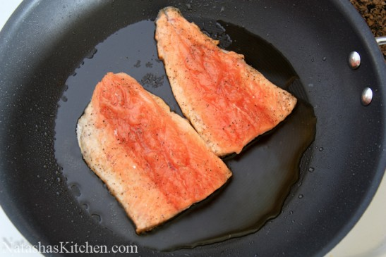Two trout fillets on a skillet