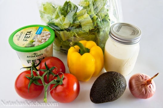 Ingredients for avocado feta Caesar salad on the table