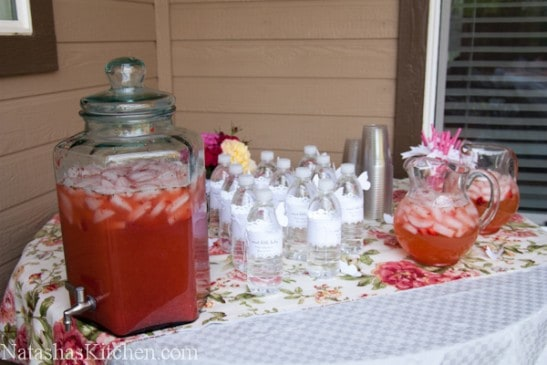 A drink corner with pink drinks, for a baby shower