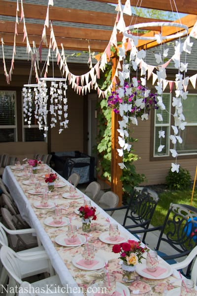 A decorated table with streamers hung up