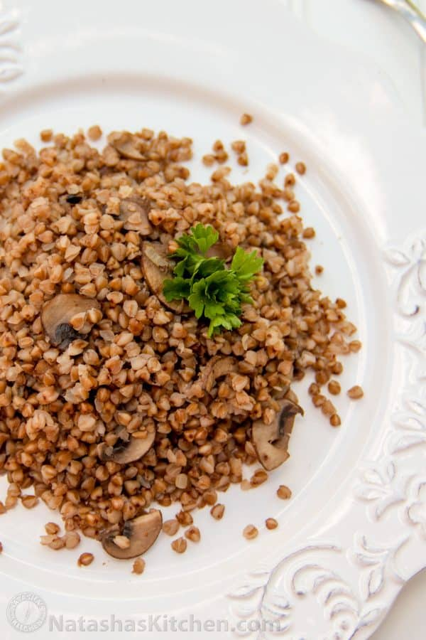 Buckwheat and mushrooms on a white plate