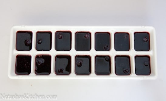 Strawberry and blueberry liquid poured into an ice cube tray