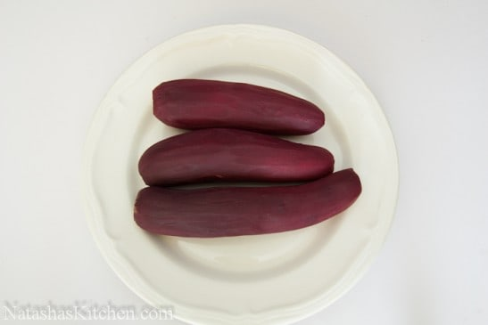 3 cooked and peeled beets on a plate
