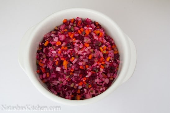 A bowl with Russian vinaigrette with beets and sauerkraut