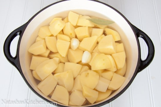 Seasoned, diced potatoes in a dutch oven