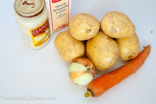 Ingredients on the table for potatoes in alfredo sauce
