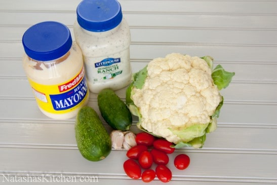 Ingredients on the table for cauliflower, cucumber and tomato salad