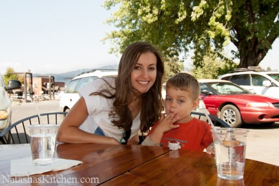 Natasha and her son sitting at a picnic table