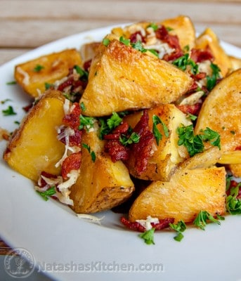 Oven-roasted potatoes with bacon and cheese in a plate