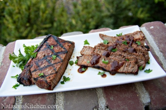 A long, rectangular plate with spice-rubbed sirloin cut into smaller pieces