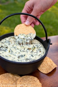 The best spinach and artichoke dip recipe served with tortilla chips in a bowl