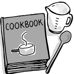 A cookbook, measuring cup and spatula