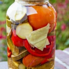 Canning Vegetables Assortment (Assorti) is the perfect way to use up your end-of-season garden vegetables in a salty/sweet pickling brine. Yum!