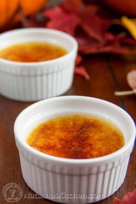 Two white glass bowls with pumpkin creme brûlées