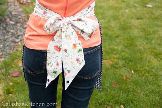 An apron tied into a large bow in the back