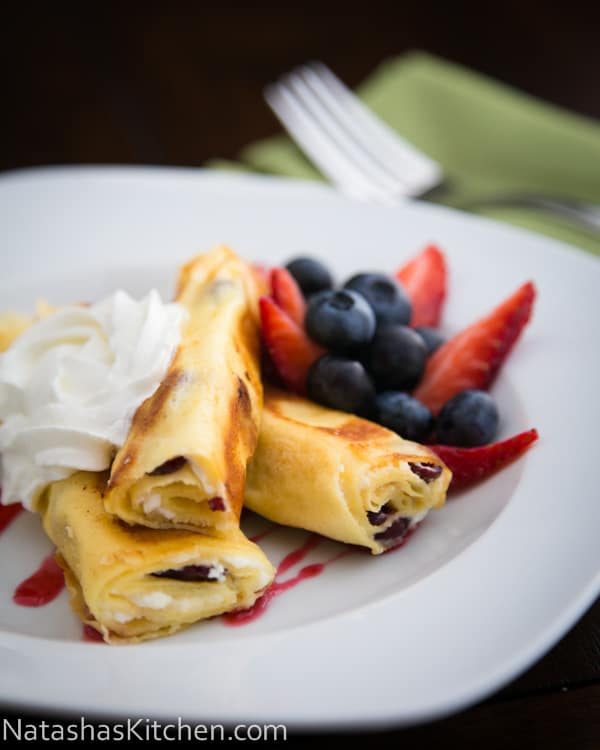 These Russian Crepes with cheese are our favorite breakfast and they can be prepared ahead of time; making it the ideal breakfast dish for company.