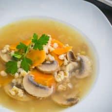 A bowl of barley and mushroom soup