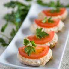 These Gouda and Tomato Tea Sandwiches (crostini) are really easy to throw together. The spread keeps well in the fridge so you can make it ahead of time.