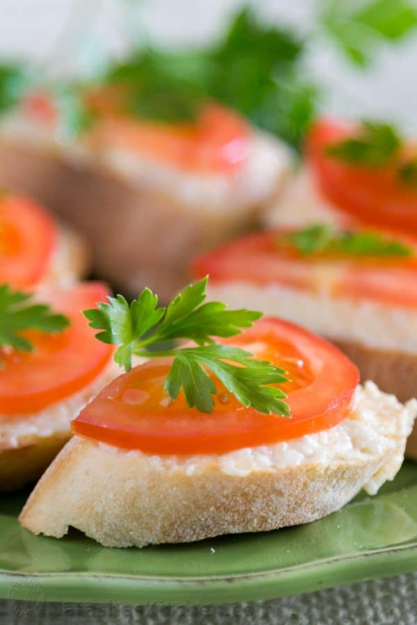 A close up of gouda and tomato tea sandwiches